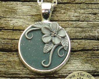 silver tone floral design on blue