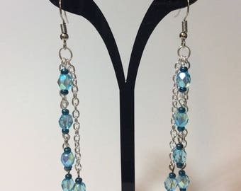 "Earrings ""Turquoise faceted pearls chained"""