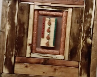Hand made piece frame with woodenembelishments
