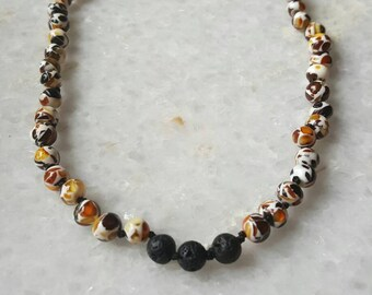 Baby baltic amber necklace with lava diffusing stone.