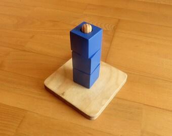 Cubes on a vertical dowel