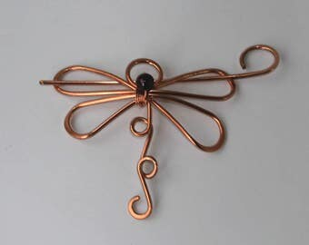 Dragonfly clip wire wrapped Garnet bead
