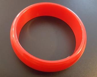 Groovy, cherry red plastic bangle
