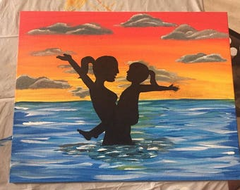 Mom and Child Playing in the Ocean