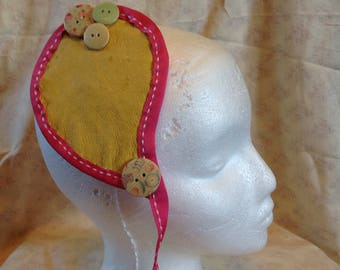 Handmade soft leather teardrop hair decoration.