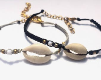 Black and gray waxed braideds bracelets with shells , white and gold beads