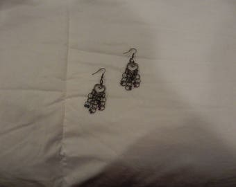 Handmade heart shape earings. About 2 inches long dangle. loops and small black stones.