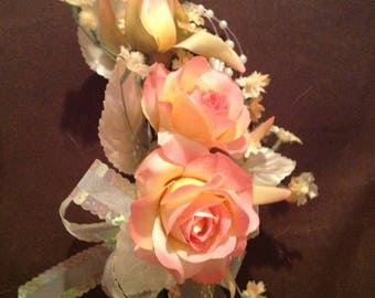 Beautiful light peach delicate roses pin on corsage