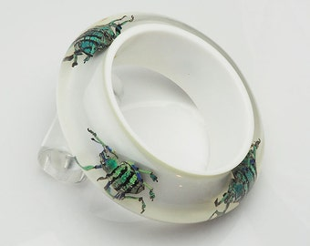 White lucite bracelet with real blue iridescent beetles