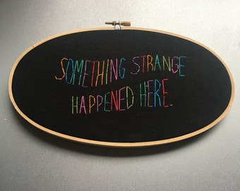 READY TO SHIP something strange - hand embroidered humorous wall hanging