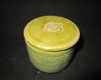 small jar with leaf imprint in spearmint green, stoneware pottery, food and dishwasher safe
