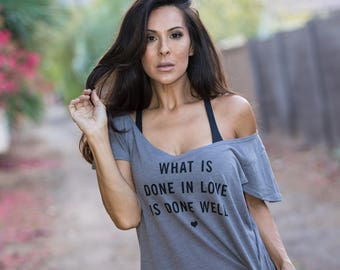 What is Done in Love is Done Well. Off the Shoulder Flutter Sleeve Flowy Muscle Tee. Made in the USA. Off the Shoulder Lounge Tee.