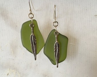 Lovely Green sea glass dangle earrings embellished with feathers
