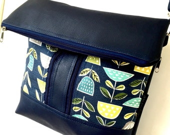 Cross body zipper vegan bag in navy with 50's inspired bark cloth fabric pockets on the front