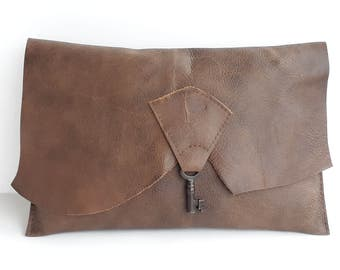 Raw edge leather clutch with vintage key - saddle brown