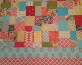 Brightly-colored queen size quilt