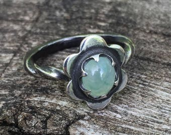 Little oxydized sterling flower ring with claw set natural pale green oval jade cabochon