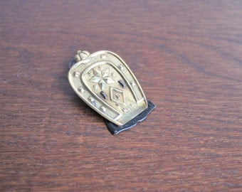 Vintage New York brass horseshoe paper clip,
