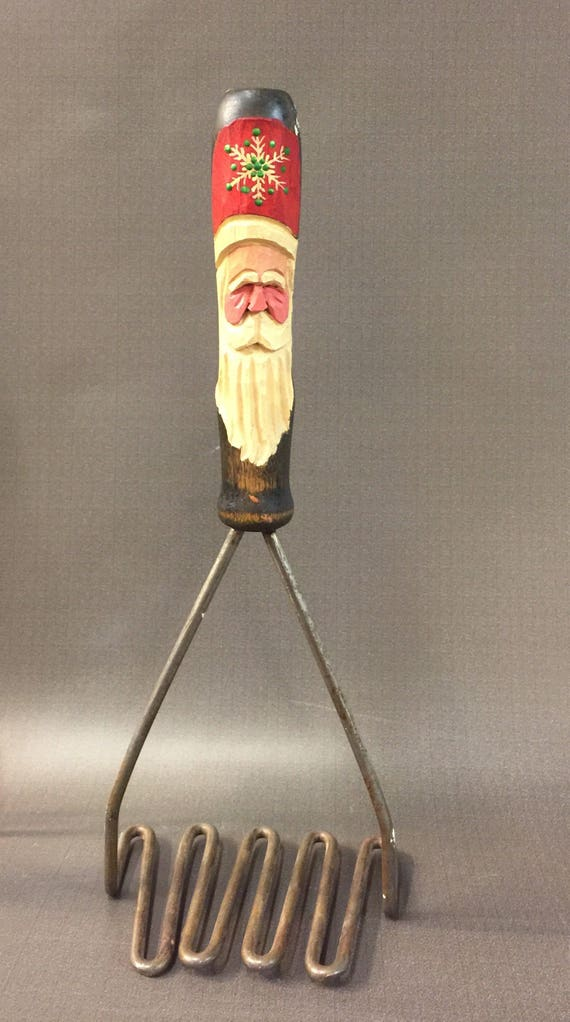 HAND CARVED Santa on an antique potato masher