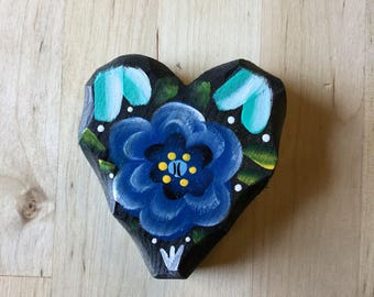 Black batea style flower on hanging wooden heart