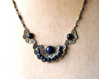 Art Nouveau vintage 30s , gold tone metal, ornate, hand crafted necklace with a small navy blue enamel flowers and plastic beads.