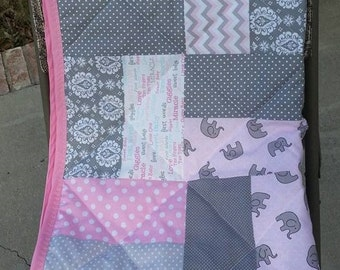 Tumbling Blocks Baby Quilt in pink, grey & white with white flannel backing