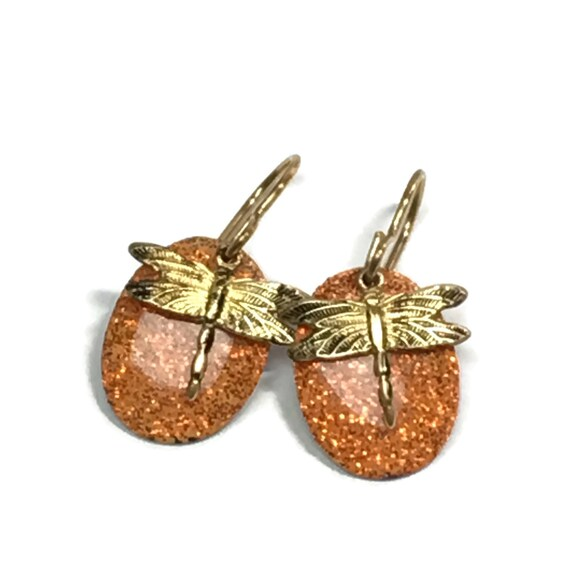 Tiny brass dragonflies on bright orange glitter ovals earrings