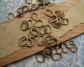 Jumprings oval - 7x6mm - 18 Gauge in Antique Gold - 50 Count