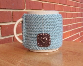 Knitted tea mug cozy tea cup cozy in antique teal with brown hanging heart patch