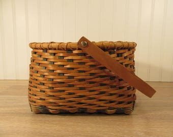 Beautiful hand made split ash basket in natural and green colors with wood rim and swing wood handle