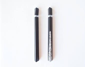 Handmade large long chandelier drop facet geometric statement dangle resin earrings in asymmetrical black with silver glitter.