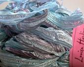sari ribbon yarn . silver 18 . 1 skein 100g 132yds . louisa harding sari ribbon . glacier blue smoky lavender . wide sparkle ribbon art yarn