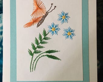 Orange butterfly with blue flowers
