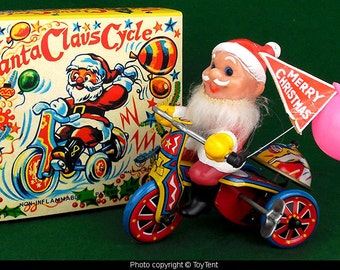 Santa Claus Cycle tin wind-up tricycle with ringing bell