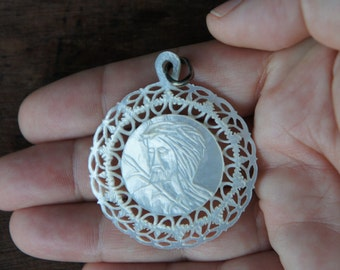 Antique Hand Carved Mother of Pearl Pendant Depicting Jesus with Crown of Thorns