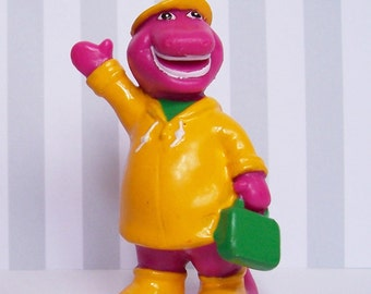 Barney Dressed With Yellow Raincoat Hat Boots & Green Bag Figure PVC Cake Topper 1993 by Unique