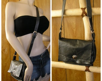 "Black leather crossbody purse, 9"" x 6"" x 2"", adjustable strap 43"" to 49"", twist latch, one front pocket & one inside pocket"