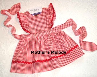 Red Gingham Pinafore Dress or Jumper with flutter sleeves.   Made to order in sizes 1T, 18 months and  2T. Trimmed in red rick rack.
