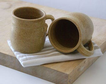 Two stoneware pottery coffee mugs - glazed in natural brown with tiny mouse
