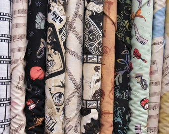 Movie/Music Fabric Fat Quarter Set of 12-All Kinds/Colors Music/Movie Related Prints for Quilts, CLothing, Tote Bags, Mixed Media,etc