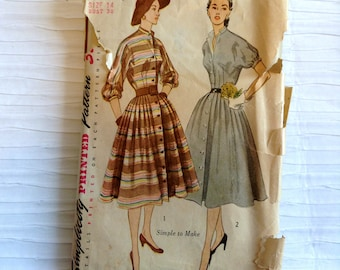 Vintage 1950 Day Dress sewing pattern.   Simplicity.   Misses Size 14.   Bust size 32.  No. 3768.
