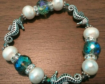 Gorgeous OOAK (one of a kind) Freshwater Pearl,  Crystal and  Seahorse Ocean inspired stretchy bracelet.  Check out my other listings. Ooaks