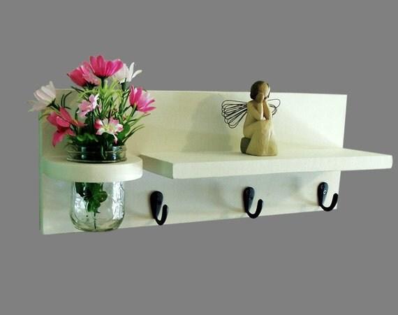 Shelf with mason jar and key hooks and jar