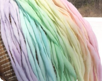 Handspun thick and thin yarn, hand dyed in pastel rainbow merino wool, 69 yards 3.65 ounces/104 grams