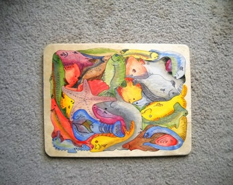 Wood, hand cut and hand painted jigsaw puzzle with fish, lots of fish!