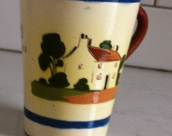 """Torquay Pottery Mug, Made in England, House Illustration, """"If you can't be easy be as easy as you can""""."""