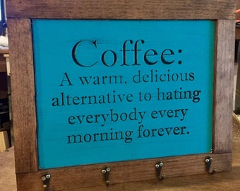 Engraved coffee sign with coffee mug hooks Comes with four coffee cup hooks and stained trim Choose color for sign at checkout