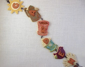 "Ceramic Wall Hanging (6 items) Spells Out ""Garden"" - Decorative String with Six Different Gardening-Themed Items - Sun Watering Can & More"