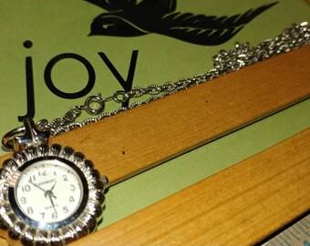 Silvertone watch necklace by Claremont. Quartz Japan Needs 377 battery