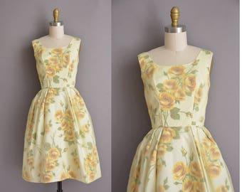 vintage 1950s dress. 50s yellow chiffon rose print vintage dress